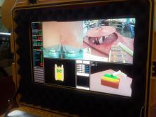 Отработка технологии открытия крышки узла загрузки с помощью комплекса МРК-27-МА-БАЭС на специальном стенде-имитаторе (фотография с поста управления)